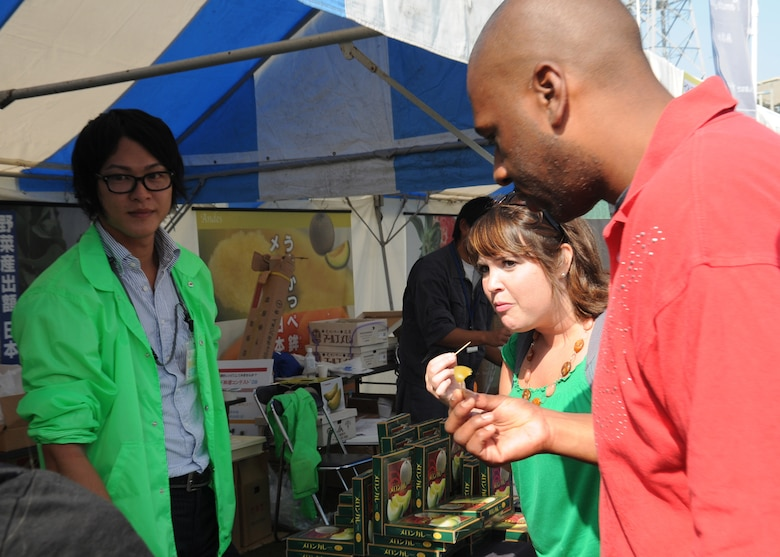 Staff Sgt. Ronderick Thrower, from the 18th Equipment Maintenance Squadron, and Ms. Beth Gosselin, Chief of Public Affairs Operations, both at Kadena Air Base, Japan, taste the local food at a farm festival during their visit to Hyakuri Air Base, Japan, Oct. 03. The squadron is participating in an Aviation Training Relocation exercise between the U.S. Air Force and the Japan Air Self Defense Force from Oct. 5-9, 2009.
