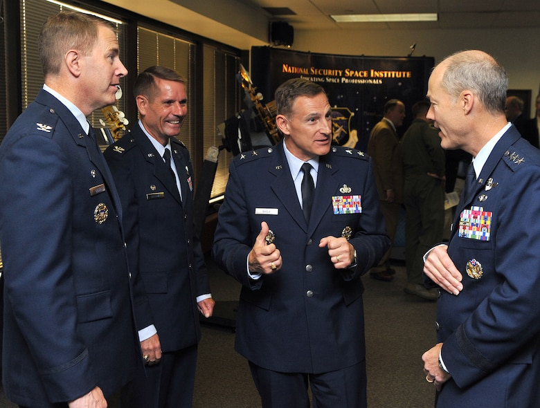 (R to L) Lt. Gen. Allen B. Peck, commander, Air University, Maxwell Air Force Base, Ala., Maj. Gen. Michael J. Basla, vice commander, Air Force Space Command, Peterson Air Force Base, Colo., Col. James P. Galloway III, commander, Ira C. Eaker Center for Professional Development, Maxwell-Gunter Air Force Base, Ala. and Col. Robert D. Gibson, commandant, National Security Space Institute, Peterson Air Force Base, Colo., talk following the reassignment ceremony at the NSSI. Oct. 1, 2009.  (U.S. Air Force Photo By Duncan Wood)