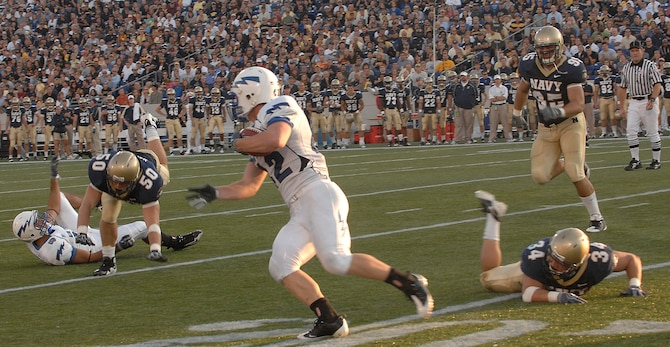Falcons running back Jared Tew runs upfield against the Midshipmen in the Air Force-Navy game at Navy-Marine Corps Memorial Stadium in Annapolis, Md., Oct. 3, 2009. Navy won the game 16-13 on an overtime field goal. The Midshipmen have won the past seven matchups against Air Force, though the Falcons still lead the series overall, 25-17. (U.S. Air Force photo/Staff Sgt. Tim Chacon)