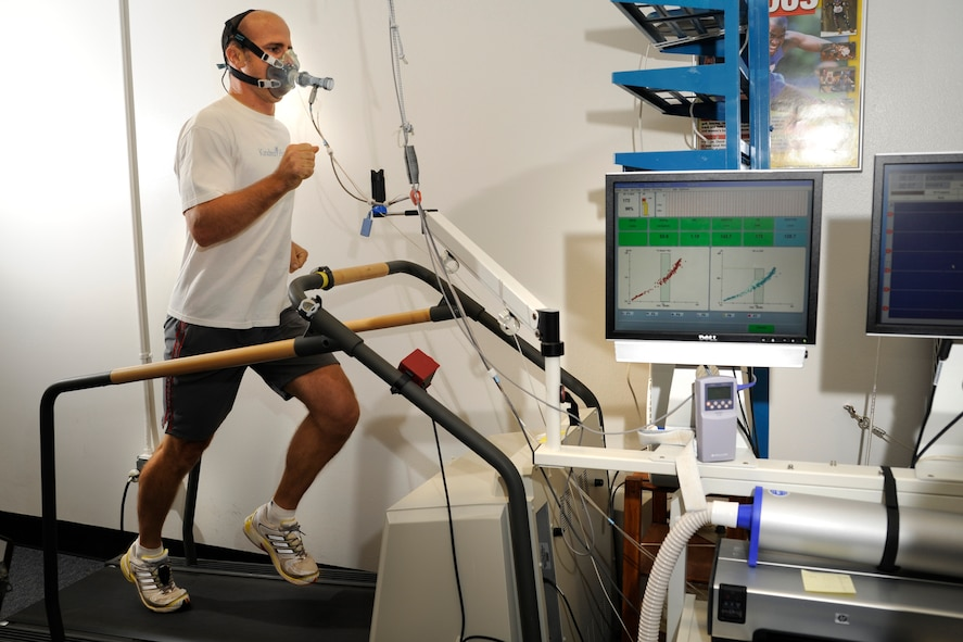 Capt. Dustin Benker runs on a treadmill at the U.S. Air Force Academy's Human Performance Laboratory Sept. 29, 2009, to check his oxygen and carbon dioxide levels while he works out. Captain Benker, a KC-135 Stratotanker pilot, is training for a marathon and triathlon. (U.S. Air Force photo/J. Rachel Spencer)