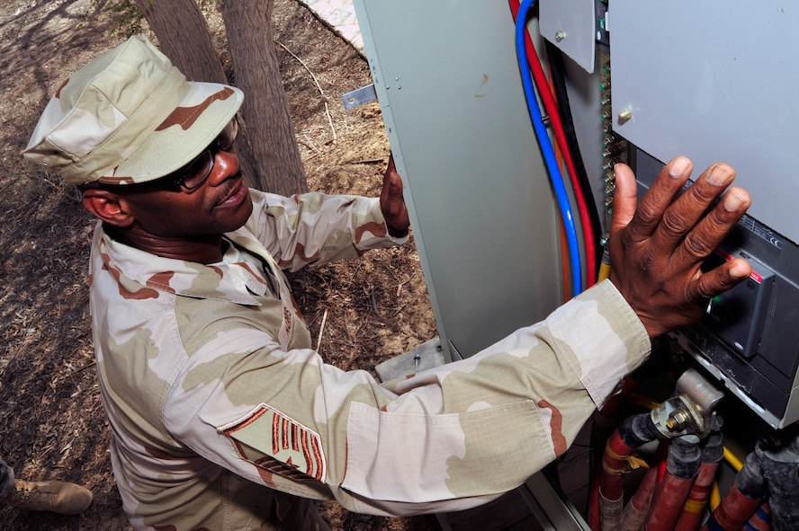 SOUTHWEST ASIA -Master Sgt. Darryl Harris, 380th Expeditionary Civil Engineer Squadron, engages the main power switch here Oct. 5, 2009. Sergeant Harris oversaw electrical operations coordinating 12 Airmen to bring electricity to 22 tents housing more than 200 soldiers. Sergeant Harris is deployed from Spangdahlem Air Base, Germany, and grew up in Detroit. (U.S. Air Force photo/Tech. Sgt. Charles Larkin Sr)