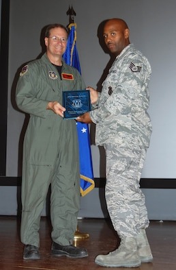 (Right) Tech. Sgt. Dwayne Jackson, 926th Force Support Squadron, is recognized Oct. 3 as the NCO of the Half. (U.S. Air Force Reserve photo by Capt. Jessica Martin)