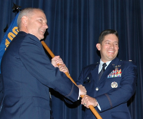 Lt. Col. Carlos Ortiz (right), 52nd Airlift Squadron commander, accepts the squadron guidon from Col. David Kasberg during an activation and assumption of command ceremony Oct. 3, 2009, at Peterson Air Force Base, Colo. The 52nd AS is active associate C-130 unit that will work with reservists in the Air Force Reserve's 302nd Airlift Wing at Peterson. Colonel Kasberg commands the 19th Operations Group at Little Rock AFB, Ark., which oversees the 52nd AS. (U.S Air Force photo/Tech. Sgt. Daniel Butterfield)