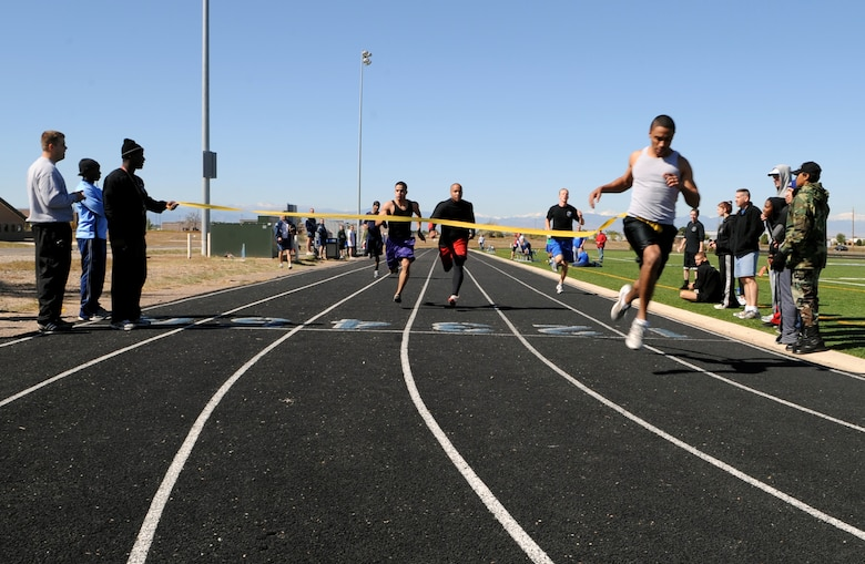 Buckley Air Force Base, Colo. – Anthony Simmons, 566 Intelligence Squadron, wins the 100-yard dash during Buckley's Sports and Field Day Oct. 2. Simmons won with a time of 11.79 seconds. (U.S. Air Force photo by Senior Airman Erika Brooke)
