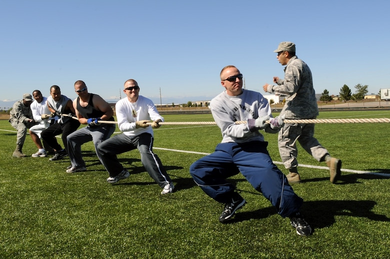 Buckley Air Force Base, Colo. – The 460th Civil Engineer Squadrons pulls Detachment 6 across the line during a tug of war game during Buckley's Sports and Field Day Oct. 2. (U. S. Air Force photo by Senior Airman John Easterling)