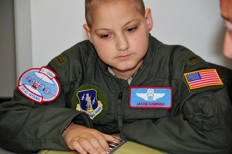 Jacob Kaminski sits in on the flight brief before his mock LC-130 mission. Jacob, 9, came to the base Oct. 6 to fulfill his dream of being a soldier for a day. After spending the day with the Army, he came to the base to see what it was like to be a pilot with the 109th Airlift Wing. Jacob has been diagnosed with leukemia. (U.S. Air Force photo by Master Sgt. Willie Gizara)