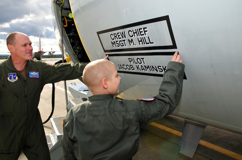 Chief Master Sgt. Don Morrell shows Jacob Kaminski his name on the LC-130 aircraft. Jacob, 9, came to the base Oct. 6 to fulfill his dream of being a soldier for a day. After spending the day with the Army, he came to the base to see what it was like to be a pilot with the 109th Airlift Wing. Jacob has been diagnosed with leukemia. (U.S. Air Force photo by Master Sgt. Willie Gizara)