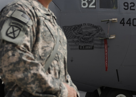 Servicemembers assembled on the flightline to tour a C-130 Hercules from the 440th Airlift Wing at Pope Air Force Base, N.C., Oct. 5, 2009, at Bagram Airfield, Afghanistan. The C-130 was dedicated to the Army's 82nd Airborne Division in honor of the cohesion of the Air Force and the Army in Afghanistan and was put on display for servicemembers to view the aircraft. (U.S. Air Force photo/Senior Airman Felicia Juenke)