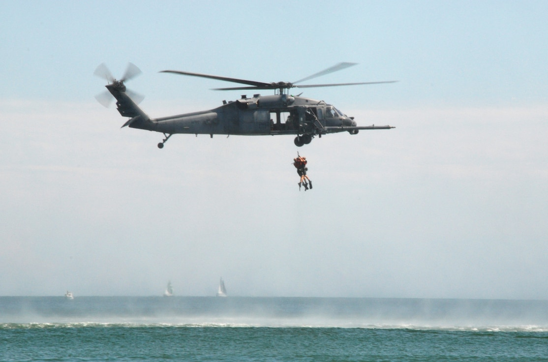 PATRICK AIR FORCE BASE, Fla. – One of the two HH-60 Pave Hawk helicopters from the 920th Rescue Wing here, simulates a rescue demonstration by hoisting two pararescuemen from the water during the Cocoa Beach Air Show Oct. 2-4, 2009. Saving lives is at the heart of everything we do. It doesn't matter if it's a downed F-16 pilot in Iraq, astronauts who have bailed out from the space shuttle, hurricane victims stranded on rooftops or a fisherman trapped aboard a sinking ship in the Atlantic Ocean. If the 920th Rescue Wing gets the call, we're going to get them to safety. (U.S. Air Force photo by/Master Sgt. Bryan Ripple)