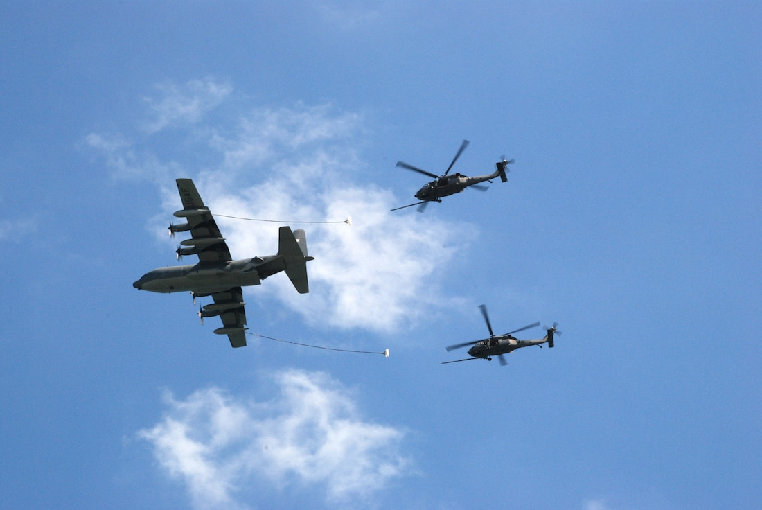 PATRICK AIR FORCE BASE, Fla. – An HH-60 Pave Hawk from the 920th Rescue Wing here, shows off its superior pilots, crew and agility during an air-to-air refueling demonstration during the Cocoa Beach Air Show Oct. 2-4, 2009. The 920th Rescue Wing is always looking for good people who want to be a part of the nation's premier Combat Search & Rescue Wing – We need support in a variety of capacities. Stop by your local recruiter for more information. (Courtesy photo by/Robert Scott)