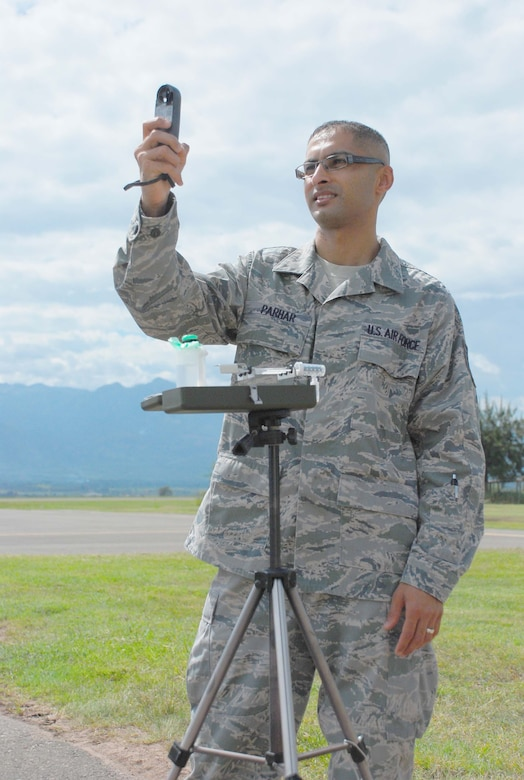 SOTO CANO AIR BASE, Honduras — Tech. Sgt Dasveer Parhar, an Air Force weatherman with the 612th Air Base Squadron, measures winds, temperature, dewpoint and pressure with a handheld Kestrel Oct. 5 in front of the base operations building. Sergeant Parhar was recently named the 12th Air Force NCO of the Quarter. He said he has been a weatherman for 11 years, and he likes how important weather is to the mission (U.S. Air Force photo/Staff Sgt. Chad Thompson).