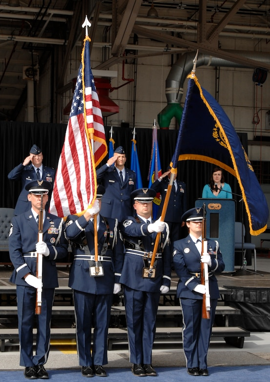 Pease Air National Guard Base, N.H., Honor Guard members begin the 64th Air Refueling Squadron activation and assumption of command ceremony, Oct. 2, 2009, with a salute during the singing of the national anthem.  (U.S. Air Force photo/Senior Airman Laura Suttles)