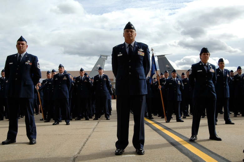 Members of the 157th Air Refueling Wing, Pease Air National Guard Base, N. H., stand at parade rest, Oct. 2, 2009, during a ceremony activating the 64th Air Refueling Squadron at Pease. Airmen from Air Mobility Command bases around the globe, including McConnell, recently moved to Pease to form the 64th ARS, the first active-duty unit to return to Pease since 1991. Once the squadron is at full strength, it will have between 120 and 130 members. (U.S. Air Force photo by Staff Sgt. Amanda Currier)