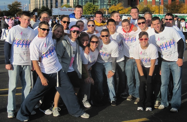 Members of the Air Force Academy men's and women's gymnastics teams pose for a group photo at the Susan G. Komen Race for the Cure in Denver Oct. 4. The teams raised more than $2,000 for breast cancer research. (U.S. Air Force photo courtesy of Athletic Communications)