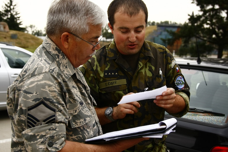 Contracting specialist Master Sgt Robert Pena works side-by-side with his Czech counterpart on purchasing issues.  Members of the Texas Air National Guard's 149th Fighter Wing were in the Czech Republic conducting mutual training as part of the National Guard's state partnership program.  (U.S. Air Force photo by Senior Master Sgt Miguel Arellano)