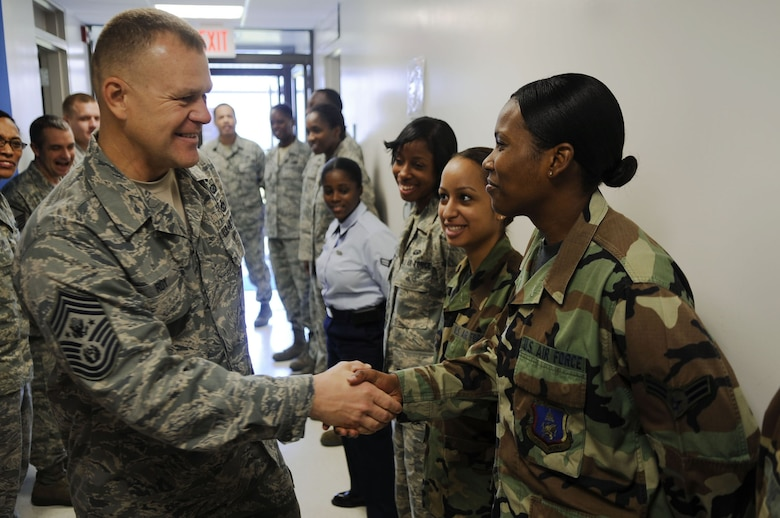 Chief Master Sgt. of the Air Force James A. Roy meets Airman 1st Class Ashley Adams during a visit Oct. 7, 2009, to Joint Base Andrews Naval Air Facility Washington. Chief Roy met with Airmen to thank them for their support. Airman Adams is a 316th Force Support Squadron career development technician. (U.S. Air Force photo/Senior Airman Steven R. Doty)