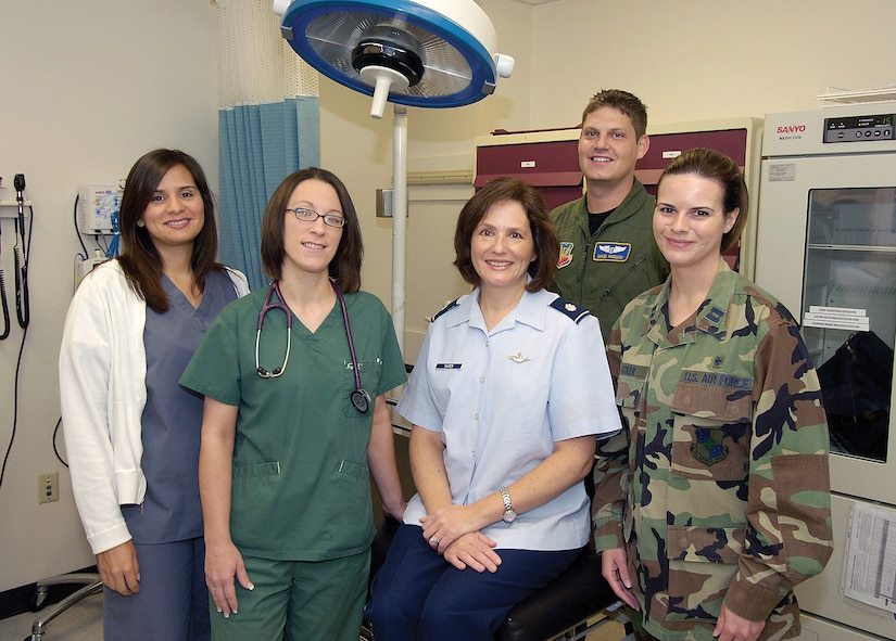 Lt. Col. Monique Yates credits an unknown Airman and a medical team of the 72nd Aerospace Medical Squadron for her survival from a life-threatening allergic reaction.  Members of that team join Colonel Yates recently as she returned with thanks for their help.  From left are; Angelica Lopez, LPN; Amanda Jordan, LPN; Capt. (Dr.) Daniel Pascucci; and  Capt. Nikki Tucker, RN. (Air Force photo by Margo Wright)