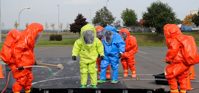 """SPANGDAHLEM AIR BASE, Germany – Members from the Full-Spectrum Threat Response Strike Team, 52nd Civil Engineer Squadron, line up to simulate body decontamination during an all hazards response training emergency management and mass casualty exercise Oct. 7. The teams maintained an """"all hazards"""" mentality to provide accurate, real-world results. (U.S. Air Force photo/Airman 1st Class Staci Miller)"""