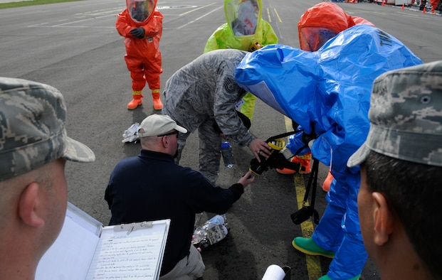 """SPANGDAHLEM AIR BASE, Germany – Members of the emergency evaluation team monitor the progress of the Full-Spectrum Threat Response Strike Team, 52nd Civil Engineer Squadron, during an all hazards response training emergency management and mass casualty exercise Oct. 7. The FSTR strike team maintained an """"all hazards"""" mentality to provide accurate, real-world results. (U.S. Air Force photo/Airman 1st Class Staci Miller)"""