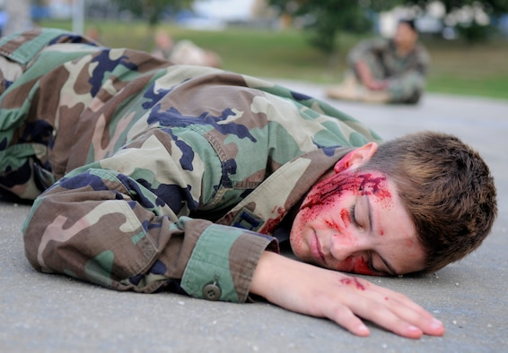 SPANGDAHLEM AIR BASE, Germany – Airman Charla Maddox, 52nd Security Forces Squadron, acts as an injured Airman during an all hazards response training emergency management and mass casualty exercise Oct. 7. All simulated casualties were instructed to act as real as possible to provide a suitable training environment for the responders. (U.S. Air Force photo/Airman 1st Class Staci Miller)