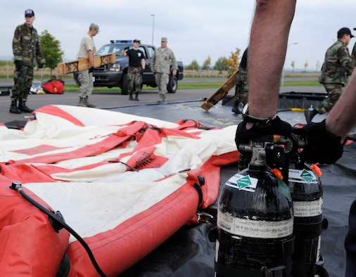 SPANGDAHLEM AIR BASE, Germany – Robert Widowsky, 52nd Civil Engineer Squadron, inflates a decontamination shower to use during an all hazards response training emergency management and mass casualty exercise Oct. 7. (U.S. Air Force photo/Airman 1st Class Staci Miller)