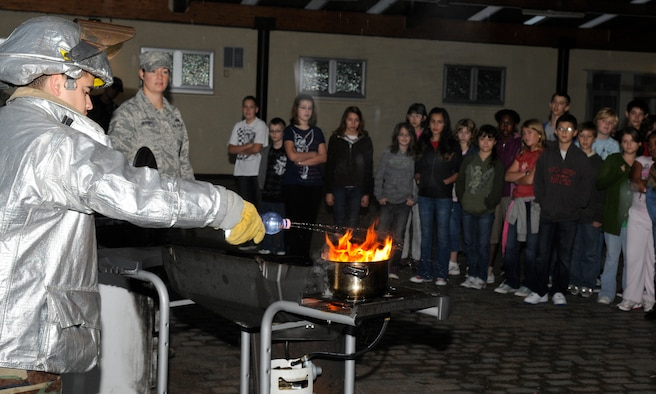SPANGDAHLEM AIR BASE, Germany – Staff Sgt. Gary Day, 52nd Civil Engineer Squadron fire inspector, demonstrates the negative effect water has on a grease fire to Bitburg Middle School fifth and sixth graders Oct. 8. The fire inspectors then showed the students how to control the fire by covering the pan with a lid. Firefighters visited the middle school as part of Fire Prevention Week Oct. 4-10. (U.S. Air Force photo/Airman 1st Class Staci Miller)