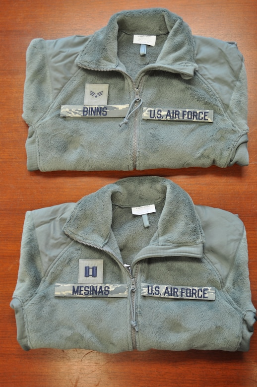 Pictured are sage green fleece outer garments with proper placement of name and rank tapes.  The 98th Air Force Virtual Uniform Board released a policy message for wearing the new Air Force sage green fleece as an outer garment for the Airmen Battle Uniform.