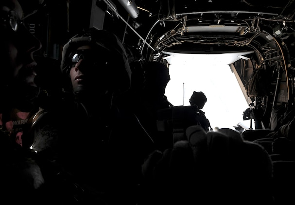 Lance Cpl. Michael R. Gravitt, rifle team leader with E Company, 2nd Battalion, 7th Marine Regiment, looks out the window of an MV-22 Osprey after taking off from the Marine Corps Air Station in Yuma, Ariz., on Oct. 10, 2009. The company's 1st Platoon flew to an urban training range in Twentynine Palms, Calif., in order to capture an insurgent leader, simulating a mission they could be called to perform during their next deployment. The battalion, based in Twentynine Palms, is scheduled to deploy with the 31st Marine Expeditionary Unit in early 2010, with E Company assigned to specialize in helicopter insertions and raids. Gravitt, 20, is a native of Moline, Ill.