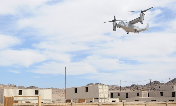 An MV-22 Osprey approaches an urban training range in Twentynine Palms, Calif., on Oct. 10, 2009, in order to pick up the Marines it dropped off less than an hour earlier. For the New River, N.C.-based Osprey pilots and crew, the helo raid was part of their training for the Weapons and Tactics Instructors course taught by Marine Aviation Weapons and Tactics Squadron 1 based at the Marine Corps Air Station in Yuma, Ariz.