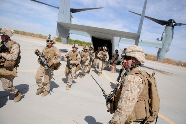 Staff Sgt. Harold Young, platoon sergeant with E Company, 2nd Battalion, 7th Marine Regiment, watches his Marines exit an MV-22 Osprey on the flight line of the Marine Corps Air Station in Yuma, Ariz., on Oct. 10, 2009, following a helicopter raid exercise. For most of the Marines including Young, the ride on the Corps' tilt-rotor aircraft was a first. The battalion, based in Twentynine Palms, Calif., is scheduled to deploy with the 31st Marine Expeditionary Unit in early 2010, with E Company assigned to specialize in helicopter insertions and raids.