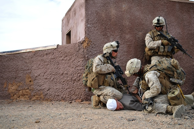 2nd Lt. Lucky Prak, 2nd platoon commander, right, watches as two Marines from E Company, 2nd Battalion, 7th Marine Regiment, detain role player Lance Cpl. Timothy Buckley during a helicopter-borne raid on a mock Middle Eastern village on U.S. Army Yuma Proving Ground, Oct. 12, 2009. The Marines landed in four different locations via UH-1N Huey helicopters around the area with the intent to clear the town and extract three high-value individuals.