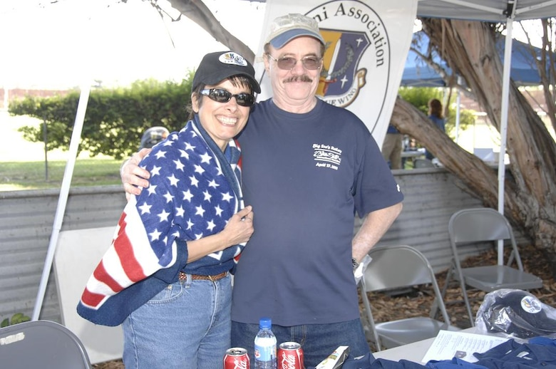 Retired 129th Rescue Wing Command Chief Master Sgt. Liliana Ramos and husband Domingo Ramos, snuggle up under the 129th RQW's Alumni Association hospitality tent Oct. 3 at the annual Family Day Picnic hosted Oct. 4 at Moffett Federal Airfield, Calif. (Air National Guard photo by Master Sgt. Dan Kacir)