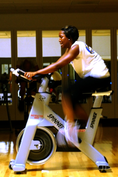 Senior Airman Tamiya Skinner, 28th Force Support Squadron fitness specialist, calls out the next exercise in a spin class at Bellamy Fitness Center here, September 15. The class is taught on a specially designed stationary cycle for an aerobic exercise. (U.S. Air Force photo/Senior Airman Kasey Zickmund)