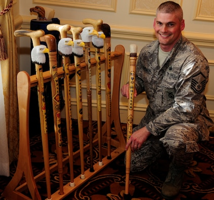 Master Sgt. Bruce Stohlman, Jr., Bolling Air Force Base Joint Visitors' Center superintendent, poses with several finished eagle head canes Oct. 7 at the Walter Reed Medical Center in Washington, D.C. Sergeant Stohlman volunteers his woodworking skills hand-carving canes for wounded veterans with the Northern Virginia Woodcarvers as part of the Eagle Cane Project. The Eagle Cane Project is an off-shoot of Soldiers' Angels, a non-profit organization providing aid and comfort to United States servicemembers and their families. (U.S. Air Force photo by Airman 1st Class Susan Moreno)