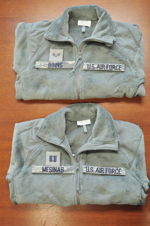 Pictured are sage green fleece outer garments with proper placement of name and rank tapes. Members of the 98th Air Force Virtual Uniform Board released a policy message for wearing the new Air Force sage green fleece as an outer garment for the airman battle uniform. (U.S. Air Force photo)