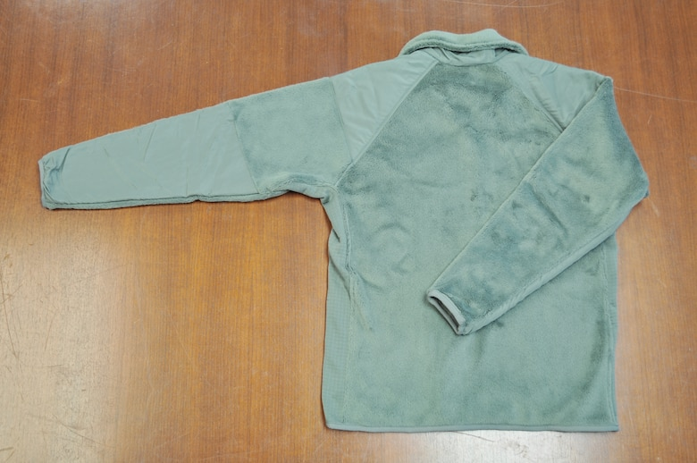 Pictured is the back of the sage green fleece outer garments. Members of the 98th Air Force Virtual Uniform Board released a policy message for wearing the new Air Force sage green fleece as an outer garment for the airman battle uniform. (U.S. Air Force photo)