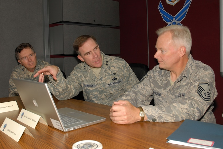 McGHEE TYSON AIR NATIONAL GUARD BASE, Tenn. -- Maj. Gen. Robert H. McMahon, center, the Air Force Director of Logistics, Deputy Chief of Staff for Logistics, Installations and Mission Support at Headquarters U.S. Air Force, reviews graphic design elements in the Nuclear Weapons Related Materiel (NWRM) Fundamentals course the Transformative Education branch is producing for the U.S. Air Force with Master Sgt. Kurt Skoglund, graphics and multimedia coordinator, right, and Col Richard B. Howard, commander, left, at The I.G. Brown Air National Guard Training and Education Center here, Oct. 8, 2009.  McMahon was at the center to videotape an introductory segment for the interactive computer based training course. (U.S. Air Force photo by Master Sgt. Mavi Smith)