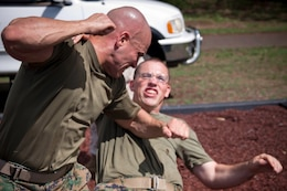 CAMP H.M. SMITH, Hawaii - Marines practice Marine Corps Martial Arts Program techniques at the recently constructed MCMAP training pit Oct. 14, at Bordelon Field. The roughly 1,800 sq. ft. recycled rubber pit promotes a safer and more effective period of instruction with its forgiving surface to lessen the danger of injury.