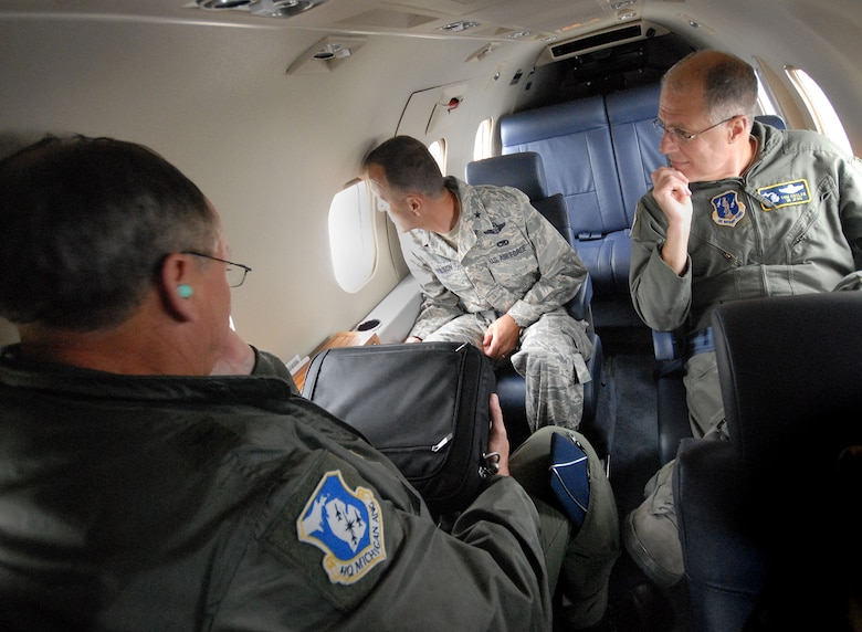 Brig. Gen. Robert Johnson, left, Brig Gen. James R. Wilson, center and Maj. Gen. Thomas Cutler, Adjutant Gereral of the Michighan National Guard, get a view of Fort Custer as they depart Battle Creek on the first flight of the C-21 from the 110th Fighter Wing Air National Guard Base, Saturday, Oct. 3, 2009.  (Photo by Master Sgt. Dale Atkins)