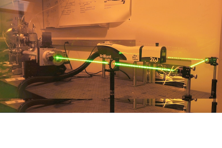 """A 200-milliJoule pulse laser fires in this timed exposure Oct. 9, 2009, at the U.S. Air Force Academy in Colorado Springs, Colo. The laser is used for a variety of experiments, including tests to determine how """"pushing"""" sulfur into a silicon-based solar cell increases the cell's efficiency. (U.S. Air Force photo/Rachel Boettcher)"""