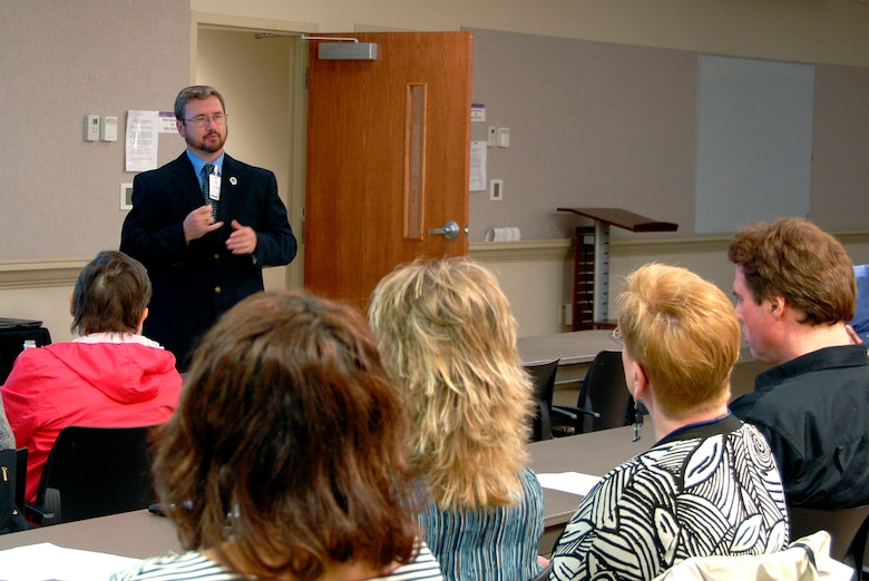 "MCGHEE TYSON ANGB, Tenn. -- John Hawk, the Advanced Distributed Learning team lead for the Transformative Education branch at The I.G. Brown Air National Guard Training and Education Center, standing, gives a presentation on ""Educating Employees with Disabilities"" to Oak Ridge Associated
