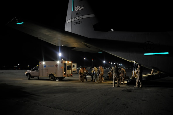Airmen from the 451st Aeromedical Evacuation Squadron transport Afghan patients from an HC-130 Hercules at Camp Bastion Oct. 6, 2009. (U.S. Air Force photo/Staff Sgt. Angelita Lawrence)