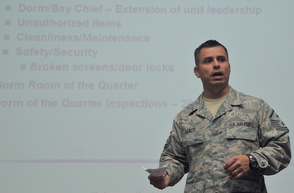 SPANGDAHLEM AIR BASE, Germany -- Master Sgt. Michael Garcia, 52nd Force Support Squadron first sergeant, briefs dorm residents on what is and isn't allowed in the dorm rooms during a dorm resident all-call Oct. 13. Key topics discussed during the briefing were dorm improvements, the no-smoking policy, base dorm council, and dorm or bay chief program. (U.S. Air Force photo/Airman 1st Class Nick Wilson)