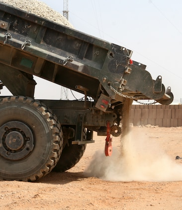 A pile of stones are emptied from the bed of a dump truck at Combat Outpost 160K, Iraq, Oct. 16, 2009, where Marines with Engineer Company, Combat Logistics Battalion 46, conducting repairs and upgrades to the base.  One of the tasks they are performing is correcting a major drainage problem the base is having, which is causing a pool of waste water to form just outside the base perimeter. (U.S. Marine Corps photograph by Lance Cpl. Melissa A. Latty)