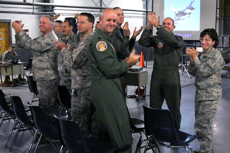 A picture of Airmen from the 177th Fighter Wing applauding.