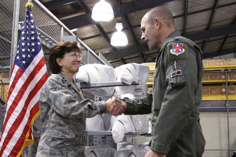 A picture of Maj. Gen. Maria Falca-Dodson New Jersey Air National Guard commander, shaking the hand of  Col. Robert C. Bolton, 177th Fighter Wing commander.