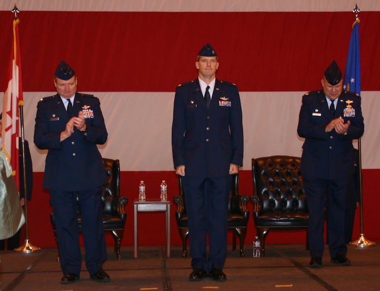 Col. George Carpenter (left), commander, 552nd Operations Group, applauds Lt. Col. David Evans (center) after he accepted command of the 552nd Training Squadron from Lt. Col. John Iwanski (right). US Air Force Photo / 1Lt Kinder Blacke