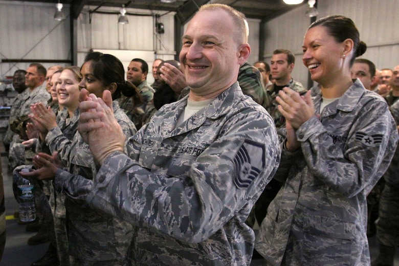 A picture of Airmen from the 177th Fighter Wing clapping.