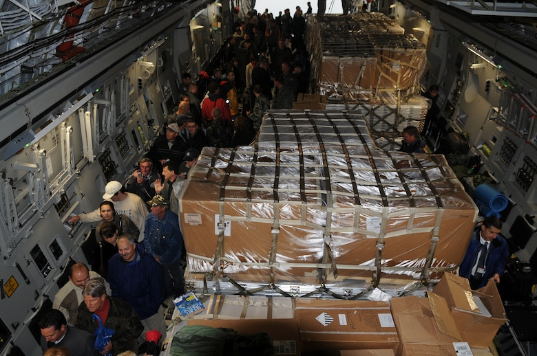 Local civic leaders, base personnel and their families tour the final C-17 Globemaster III delivered to the Heavy Airlift Wing on Oct. 12, 2009 at Papa Air Base, Hungary.  The HAW now has three C-17s available to provide a heavy airlift solution with global reach to meet national obligations to the European Union, NATO and U.N. (U.S. Air Force photo/Staff Sgt. Mercedes Crossland)