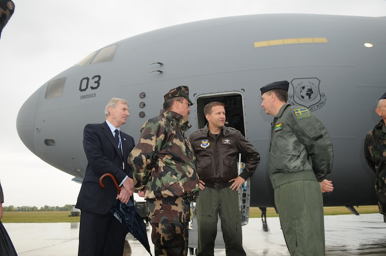 Col. John Zazworsky, Heavy Airlift Wing commander (center right), met with Swedish Col. Fredrik Heden, HAW vice commander (right), General Laszlo Tombol, Hungarian Chief of Defense (center left), and Gunnar Borch, NATO Airlift Management Agency general manager, after the delivery of the third and final C-17 Globemaster III on Oct. 12, 2009 at Papa Air Base, Hungary.  The wing's purpose is to collectively create a heavy airlift solution with global reach to meet national obligations to the European Union, NATO and U.N. (U.S. Air Force photo/Staff Sgt. Mercedes Crossland)